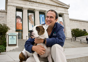 Ken Ramirez and his dog sitting outside Shedd Aquarium
