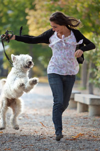 Woman running happily with her dog