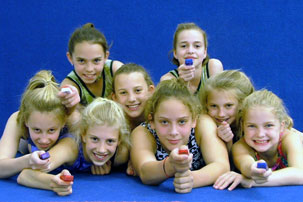 A group of young competitive gymnasts with early and frequent exposure to TAGteaching